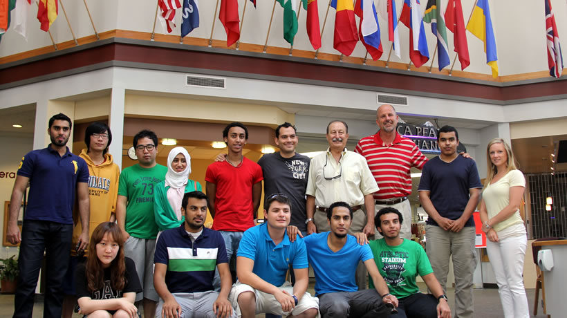 International students in the Edminster Student Union Building with President Joe Dunlap and VP of Student Services Graydon Stanley.