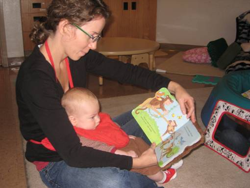 teacher reading to infant