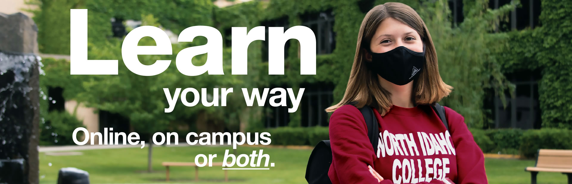 female student wearing a mask and standing near Lee-Kildow fountain - Learn your way. Online, on campus or both.